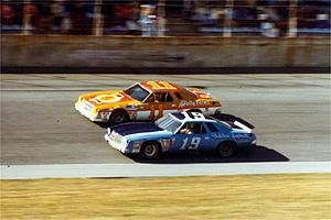 Burcham (19) races against Cale Yarborough (11) in Henley Gray's Chevy at Daytona in 1977.  Burcham would finish ninth, while Yarborough went on to win.