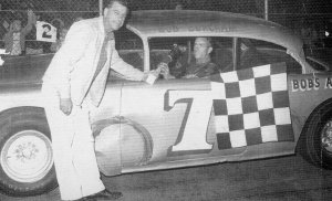 "Burcham in a familiar place, victory lane at Boyd's.  In 1962, Burcham won 28 of 30 feature events. ""One race I blew an engine.  The other Harold Fryar simply outran me."""