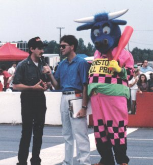 Davey Allison, along with the All Pro Bull, talk to the fans at Georgia International Speedway (now Gresham Motorsports Park) in Jefferson, GA prior to a match race in 1991.  Photo by Emory Marlow