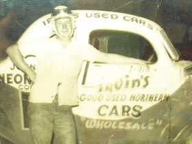 Tommie Irvin of Baldwin, Georgia, poses next to his racer at the Greenville-Pickens Speedway in the early fifties.  Photo courtesy Tommie Irvin