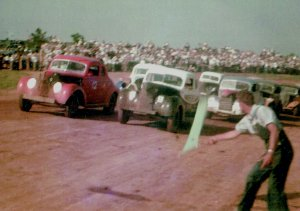 A field of cars takes the green flag in a heat race at the Jackson County Speedway on May 16, 1948.  Photo courtesy Harold & C.L. Pritchett