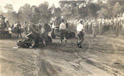 "Grim scene at city owned Lakewood Speedway near downtown Atlanta on Labor Day, 1946.  Remains of George Robson's racer, who won the Indianapolis 500 three months earlier, is in the foreground.  Ahead is the car of George ""Tex"" Barringer.  Lakewood Speedway operated until 1979 and in it's heyday was proclaimed the ""Indianapolis of the South"".  Both tracks had taken their share of lives by 1946 and they woudl continue to claim even more.  Ironically, both cars are former Indy winners.  Robson drive a different car to victory on May 30th, but before that his mangled machine seen above had won the 1938 Indy 500 withdriver Floyd Roberts.  It is alsothe very same car Roberts crashed and died in at Indy in 1939.  Barringer's car was driven to victory by Wilbur Shaw in the 1937 Indy 500.  Photo courtesy Eddie Samples"