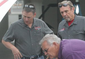Tony Gresham, pictured left, and Jim Gresham, pictured right, have a look at Cain's car between runs.  Photo by Brandon Reed