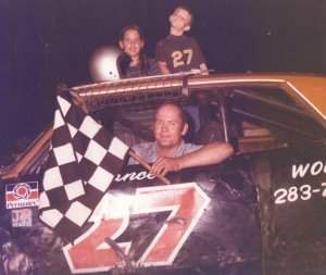 Rance Phillips, driver and owner, pictured with his daughter Lynn and his son Randy in victory lane in the late '70s. Phillips will be inducted into the Jacksonville Stock Car Racing Hall of Fame in December.
