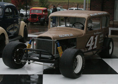 Jerry Williams displayed his beautiful replica of one of Buck Simmons' early racers out front of the Hall of Fame.