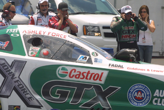John Force (pictured right) prepares to watch his daughter Ashley during a qualifying run at the 2007 Southern Nationals at Atlanta Dragway.  Photo by Brandon Reed