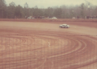One of Senoia's dirt heroes, Charlie Mincey, roars through turn one in 1969.  Photo courtesy GARHOFA
