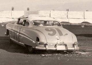 Tim Flock's day at Palm Beach came to an end after a flip when the right front axel broke on his Hudson. Photo courtesy the Marilynn Clinard collection