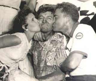 Tim Flock gets congratulated by wife Frances and brother Fonty after winning at Detroit in 1952.  Photo courtesy Frances Flock