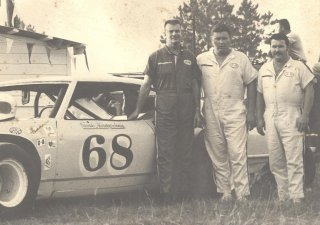 Driver Harvey Jones, and car owners, builders and mechanics Johnny Cooper and James Cooper with their race car at the Thunderbowl Speedway in Valdosta, GA.